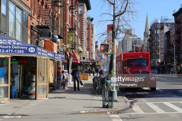 red truck parked along 3rd avenue in manhattan, new york city, usa - east village stock-fotos und bilder