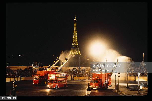 Red Trucks go down the Champs Elysees during the French Revolution Bicentennial parade conceived by designer JeanPaul Goude