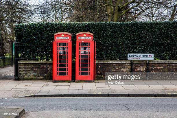 Red twin telephone booths in the City of London close to Hyde Park.