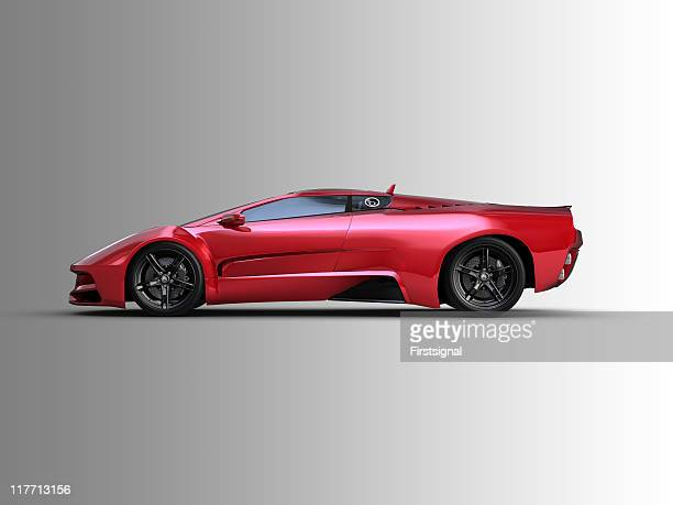Red two door sports car on grey background