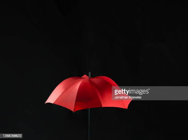 a red umbrella - bright stock pictures, royalty-free photos & images