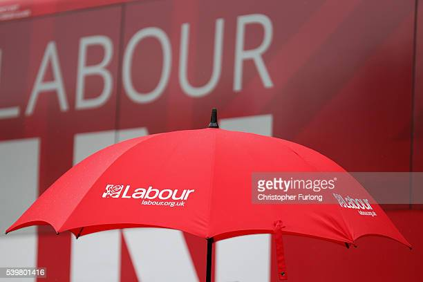 A red umbrella shields MP's as the Labours Women In For Britain campaign starts off outside Birmingham Council House in the West Midlands on June 13...