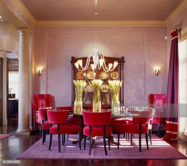 Red Upholstered Dining Chairs by Round Table