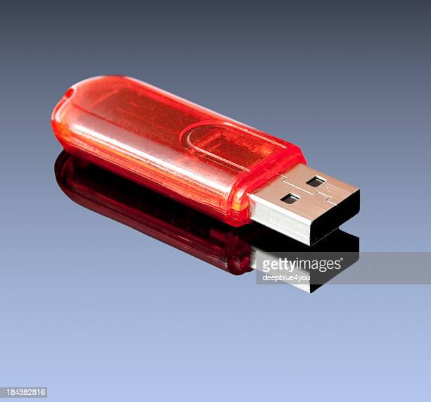 Red USB storage on blue background