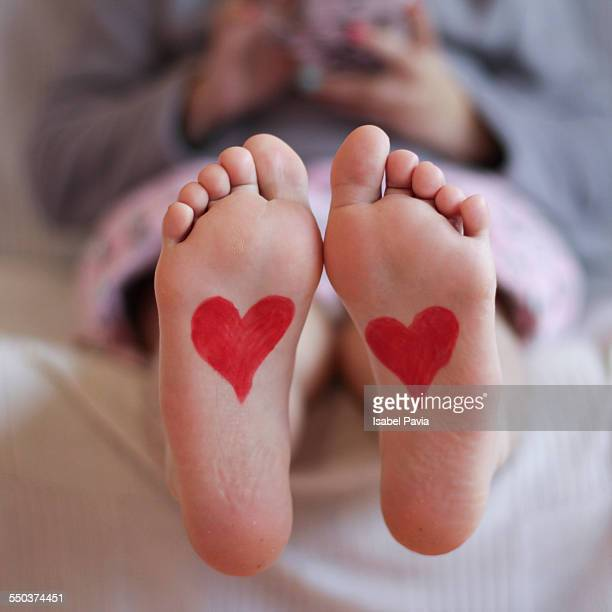 Red Valentine hearts on children's feet