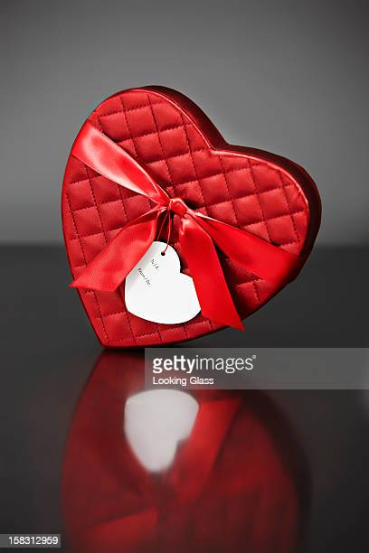red valentine's heart-shaped box - box of chocolate stock pictures, royalty-free photos & images