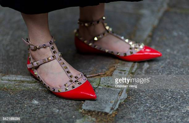 Red Valentino flats outside Valentino during the Paris Fashion Week Menswear Spring/Summer 2017 on June 22 2016 in Paris France