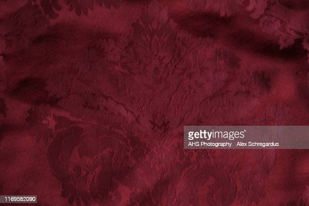 red velvet texture with print - velvet stock pictures, royalty-free photos & images