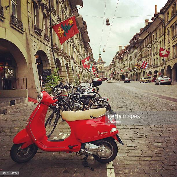 red vespa parked in old city of berne, switzerland - vespa brand name stock pictures, royalty-free photos & images