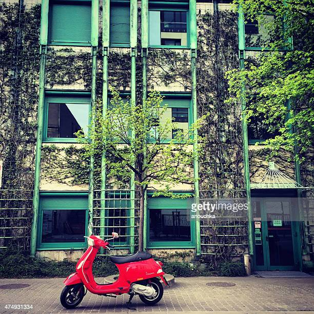 red vespa parked near university library in warsaw, poland - vespa brand name stock pictures, royalty-free photos & images