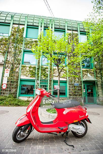 Red Vespa parked near University Library in Warsaw, Poland