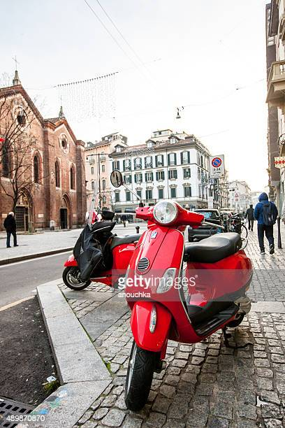 red vespa parked on milan street - vespa brand name stock pictures, royalty-free photos & images