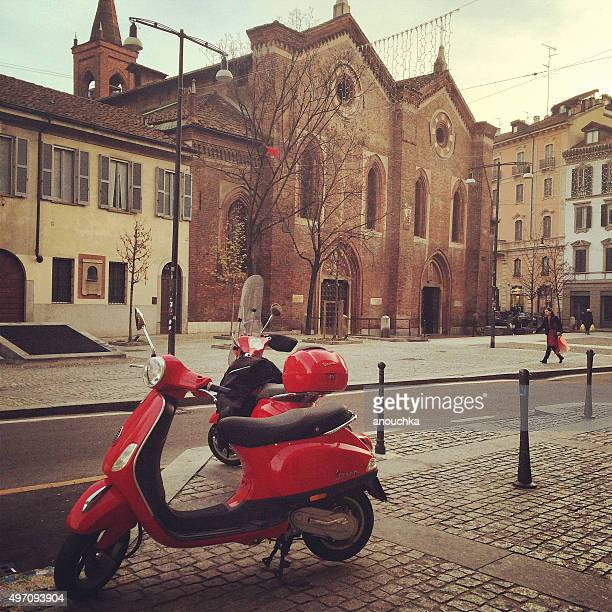 Red Vespa parked on Milan street