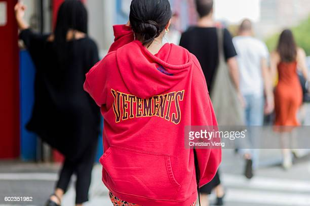 Red Vetements hoody outside Dion Lee on September 10, 2016 in New York City.