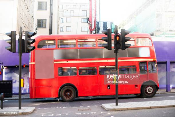 red vintage bus in london. - double decker bus stock pictures, royalty-free photos & images