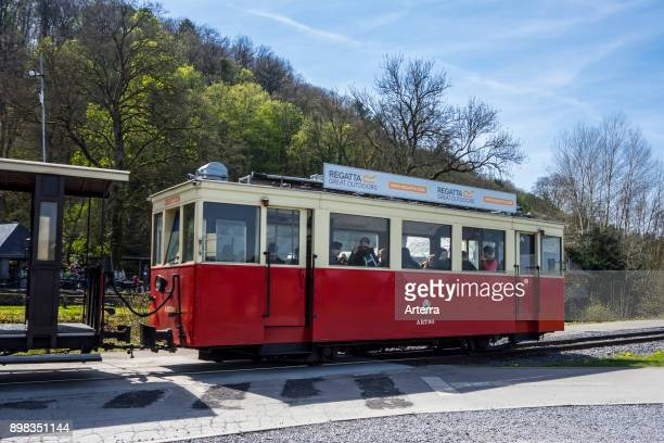 Red vintage streetcar at the estate of the Caves of HansurLesse / Grottes de Han Belgian Ardennes Belgium
