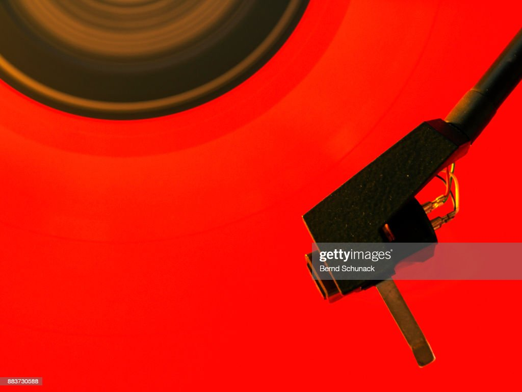 Red Vinyl on Turntable : Stock Photo
