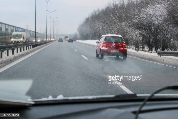 Red Volkswagen Lupo covered by the snow at the Tricity ringroad is seen in Gdansk Poland on 19 January 2018 Heavy snow fall and wind Power has been...