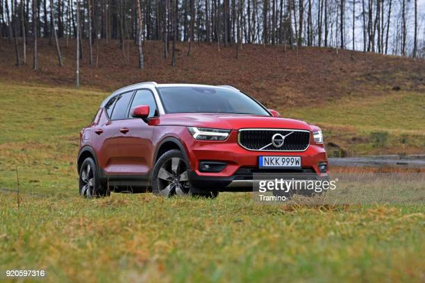 Red Volvo XC40 on the grass