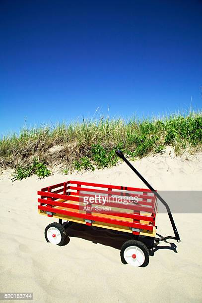 red wagon on beach - toy wagon stock photos and pictures