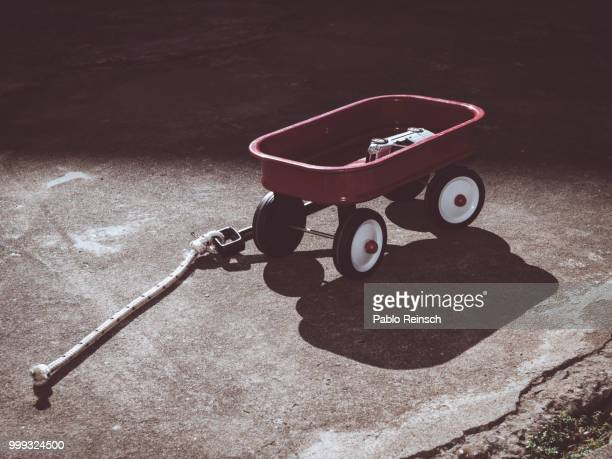 red wagon. - toy wagon stock photos and pictures