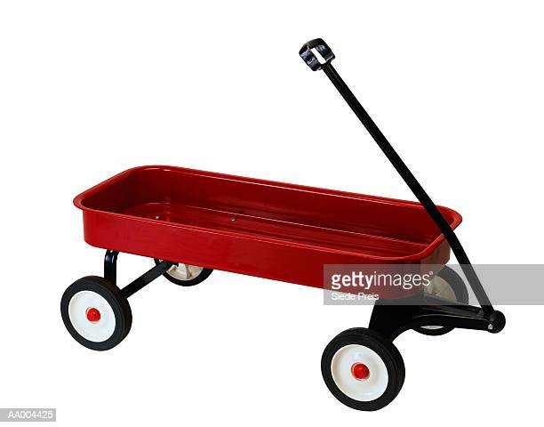 red wagon - toy wagon stock photos and pictures