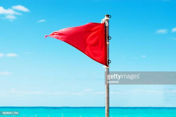 red warning flag on the beach - danger stock pictures, royalty-free photos & images