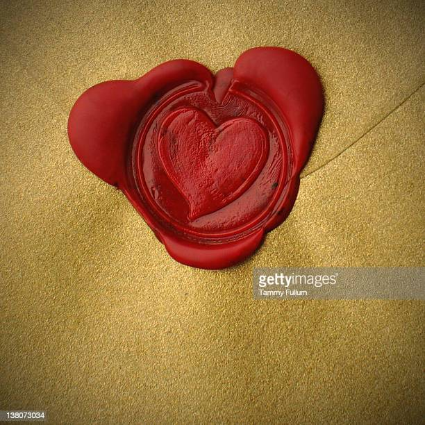 red wax heart seal love letter - love letter stock photos and pictures