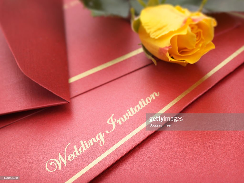 A Red Wedding Invitation With Yellow Flowers Stock Photo | Getty Images