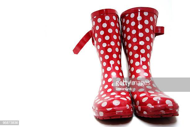 Red wellington boots with white spots on a white background