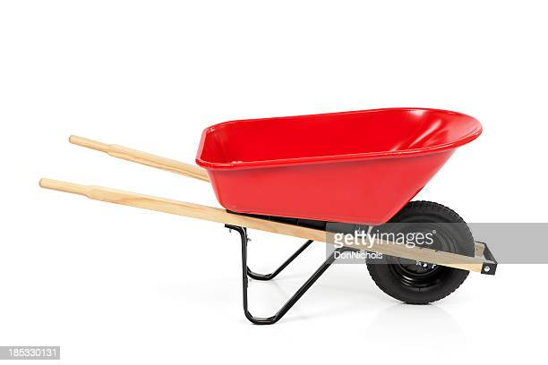 red wheelbarrow isolated - wheelbarrow stock photos and pictures