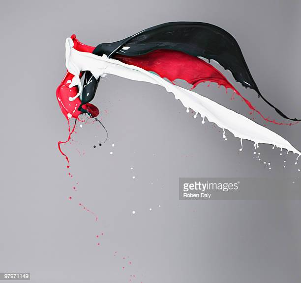 Red, white and black paint colliding