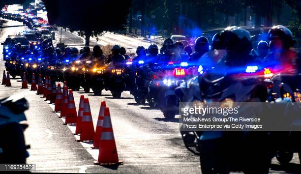 Red white and blue as far as the eye can see for fallen CHP Officer Andre Moye Jr weaves along Arlington Ave at Adams St in Riverside near Harvest...
