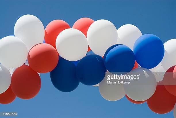 red, white and blue balloons - fourth of july stock photos and pictures