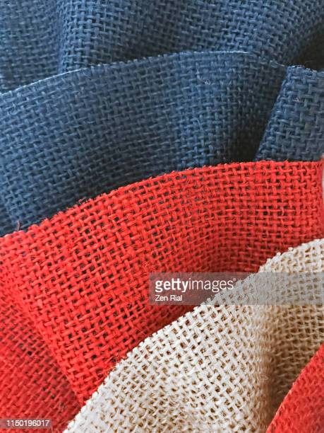 red white and blue colored jute ruffled fabric arts and craft material - woven stock pictures, royalty-free photos & images