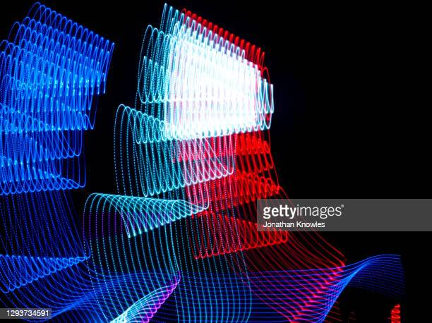 red, white and blue light lines - light trail stock pictures, royalty-free photos & images