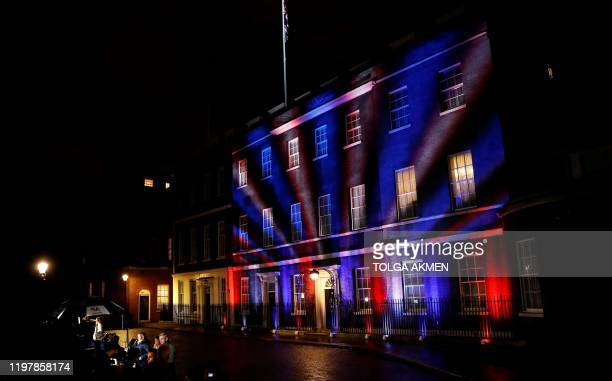 Red white and blue lights illuminate 10 Downing Street the official residence of Britain's Prime Minister in central London on January 31 after...