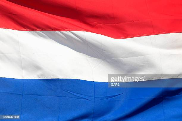 A red, white and blue Netherlands flag flying proudly