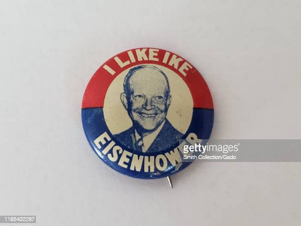 """Red, white, and blue pin-back button or badge, with a smiling headshot of Dwight Eisenhower and the text """"I Like Ike, Eisenhower"""" issued for a Dwight..."""