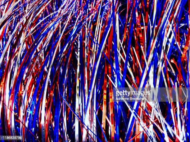 red, white, and blue tinsel - fourth of july background stock pictures, royalty-free photos & images