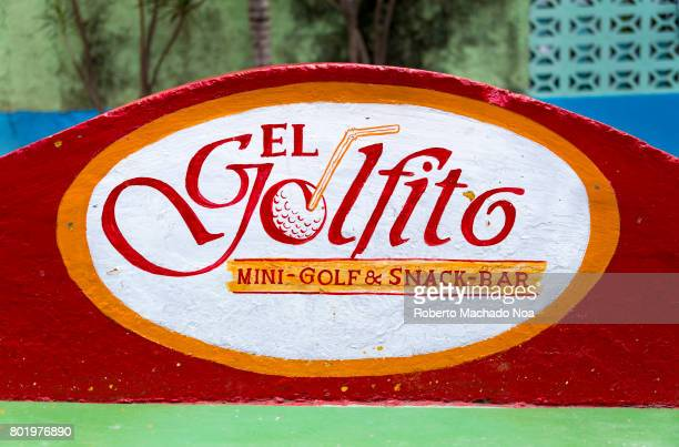 Red white and orange El Golfito minigolf and snack bar signage painted on top of a curved wall
