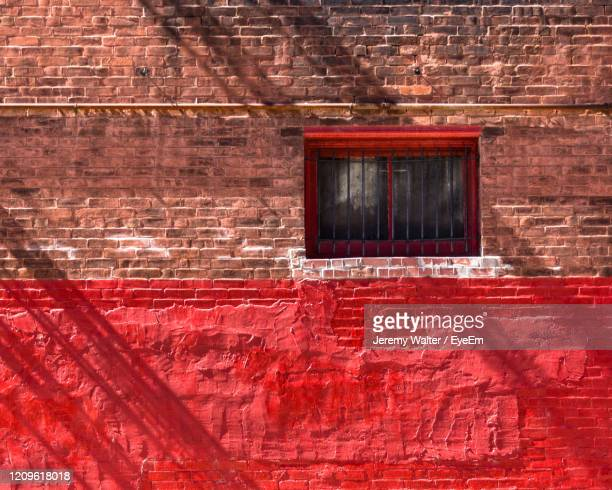 red window on brick wall - eyeem jeremy walter stock pictures, royalty-free photos & images