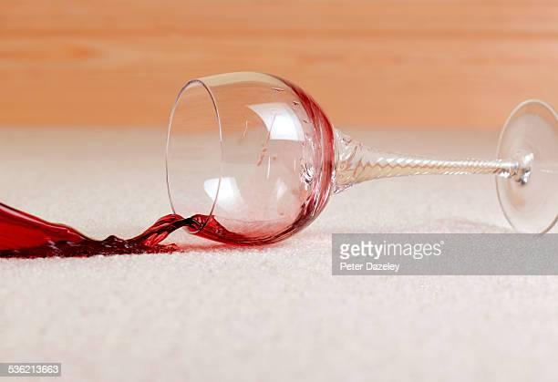 red wine accident spill on carpet - wine stain stockfoto's en -beelden