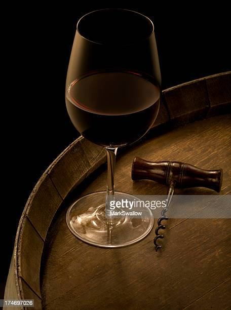 Red Wine and Corkscrew on Barrel