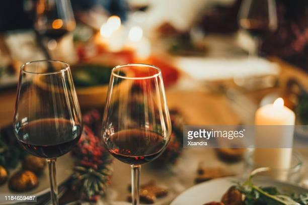 red wine at the christmas dinner table - red wine stock pictures, royalty-free photos & images