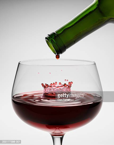 red wine being poured into wineglass - empty wine glass stock photos and pictures