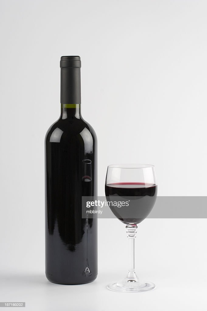 Red wine bottle and glass, isolated on white background : Stock Photo