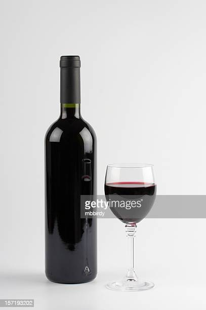 red wine bottle and glass, isolated on white background - cabernet sauvignon grape stock photos and pictures