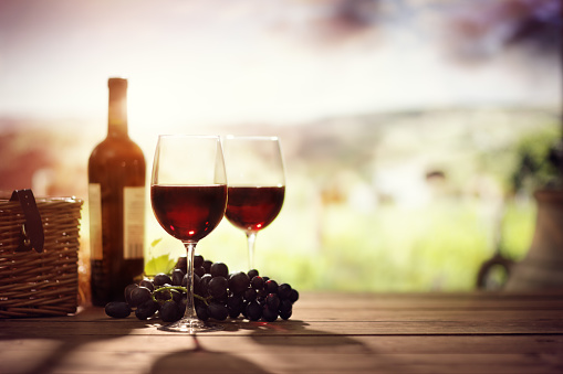 Red wine bottle and glass on table in vineyard Tuscany Italy 912129788