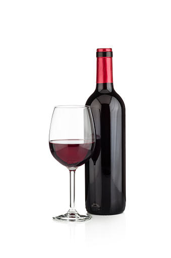 Red wine bottle and wineglass shot on white background 1089479678